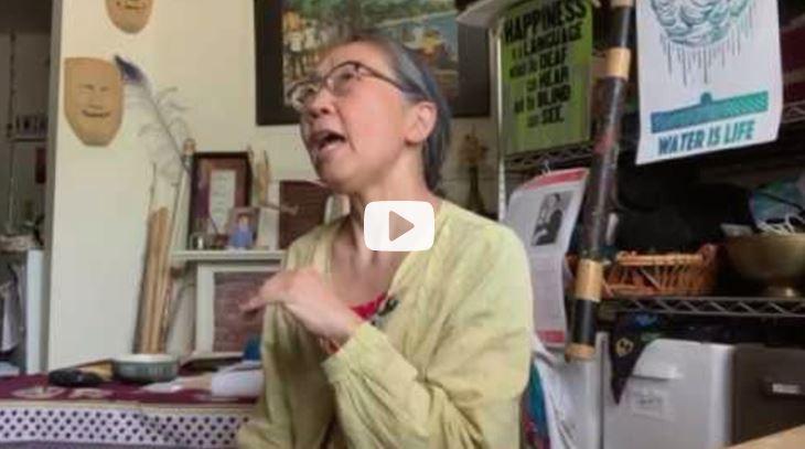 A woman wearing glasses is speaking.