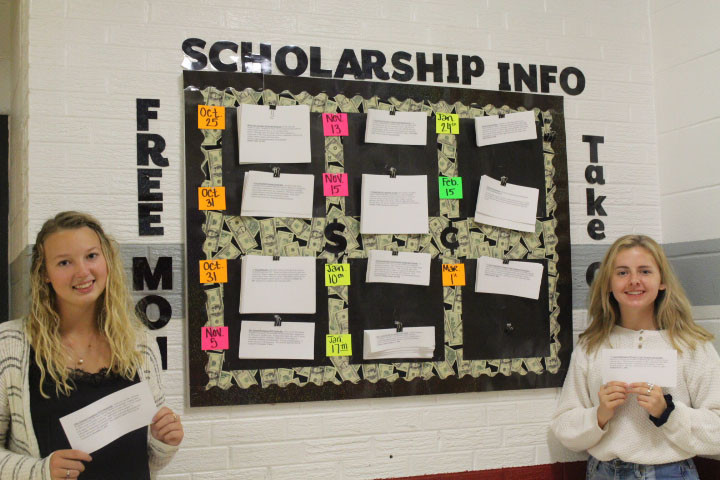 Abby Butler and Emmie Barnett are checking out the many scholarships offered.