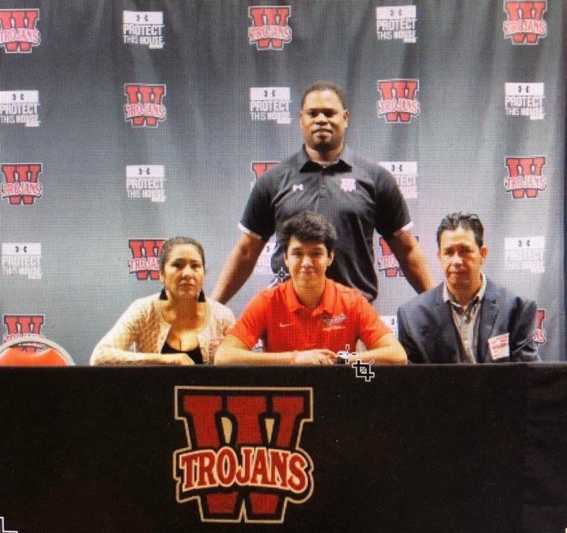 Senior Juan Villasenor signs with the University of the Cumberlands for four more years of football.