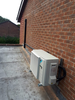 Daikin air con unit on exterior wall