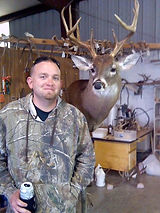 C&M Taxidermy Owner with Deer Mount