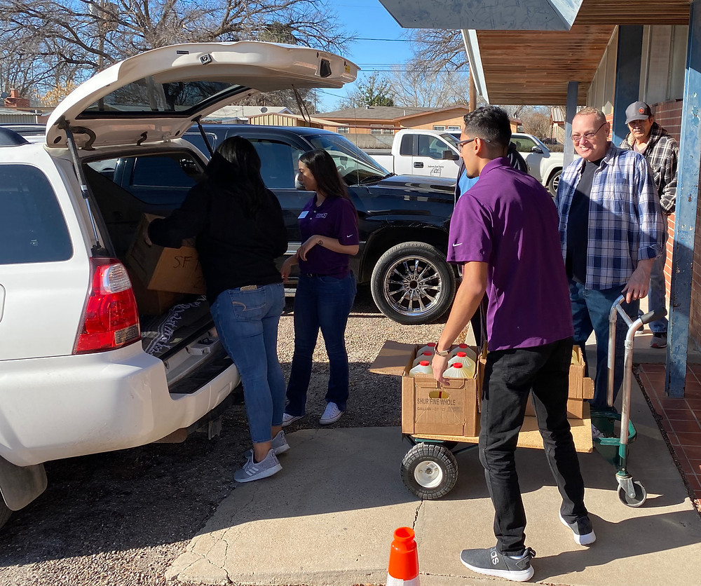 Team Members unload food items to the food pantry