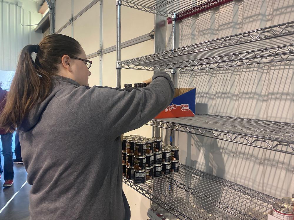 Team Member Shannon Davis helping stock shelves