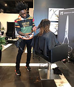 Celebrity Hairstylist Greg Gilmore wearing his Set Walk holster as he teaches a hair cutting class