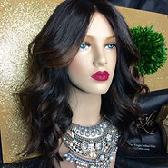 Middle part shoulder length body wavy hairstyle