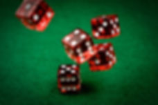 Dice rolling on green felt table
