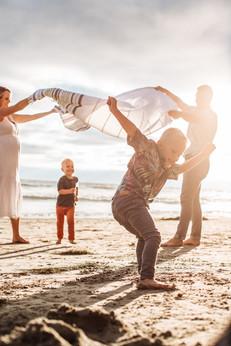 beach family maternity photo fun kids
