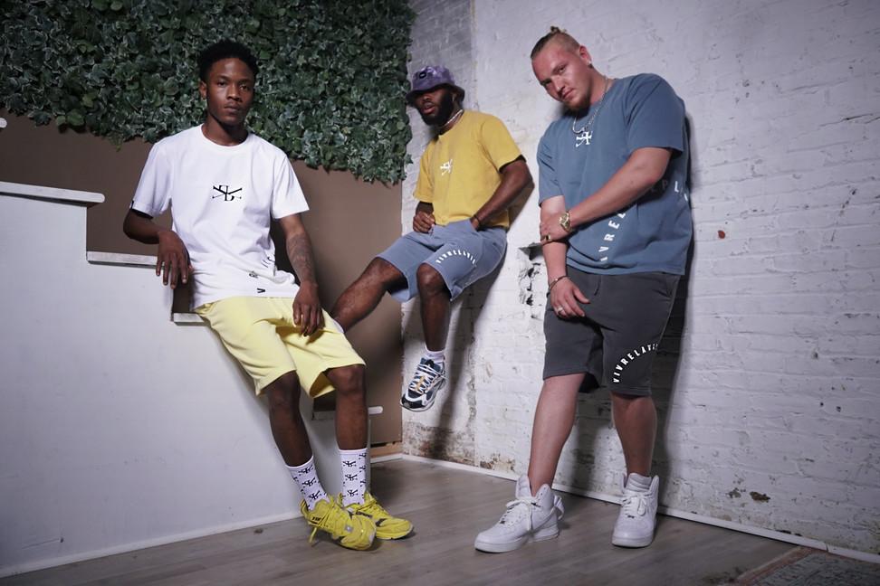 Men Posing in Philadelphia Apparel