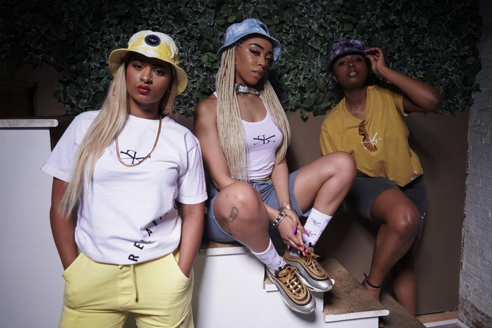 Women Posing in Luxury Streetwear