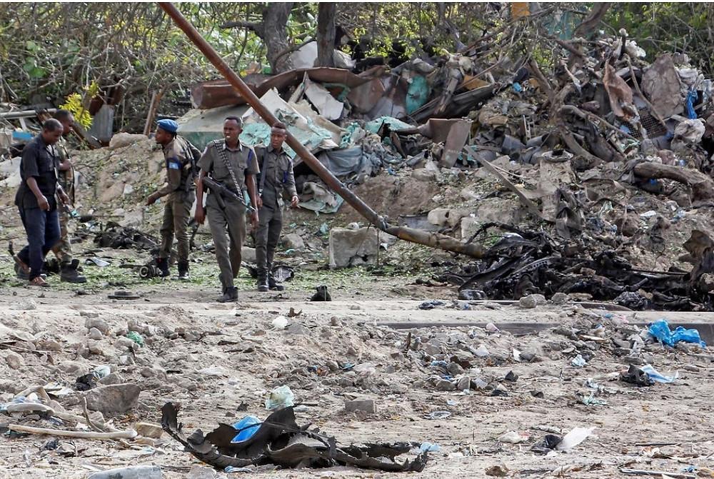 The scene of a car bomb explosion outside a tax collection center in Mogadishu, Somalia, on Saturday.Credit...Farah Abdi Warsameh/Associated Press