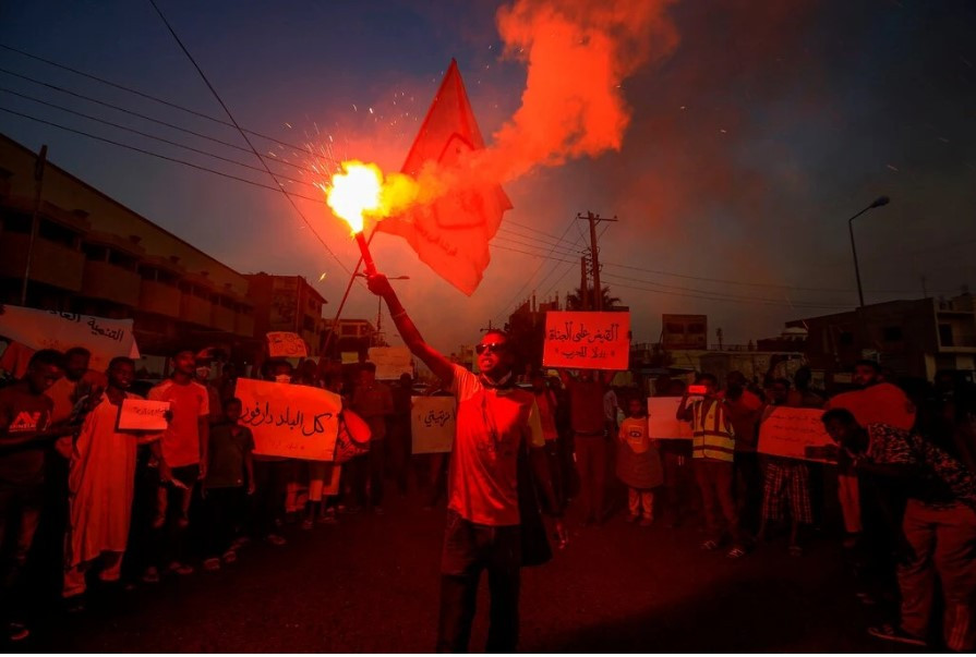 Protesters in Khartoum earlier this month called for the Sudanese government to provide security for the people of Darfur.Credit...Ashraf Shazly/Agence France-Presse — Getty Images