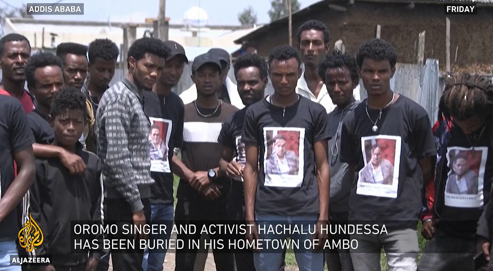 Protesters wear homemade black shirts with the singer's face on them. Source: Al Jazeera Video