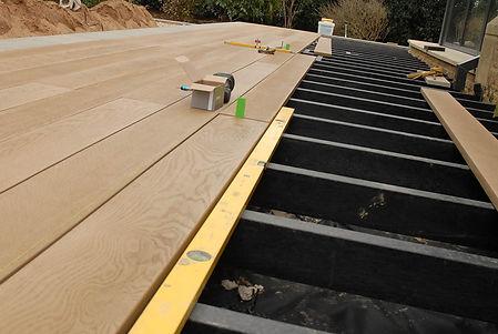Composite decking being installed