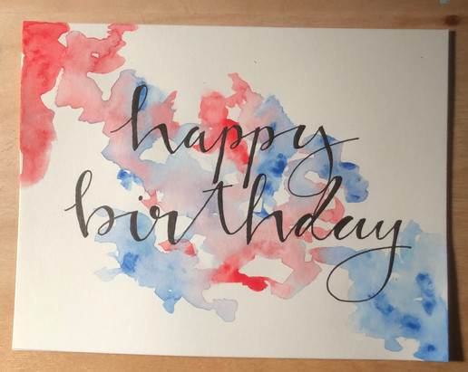 handmade happy birthday card with fancy writing and blue and red background design