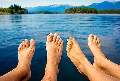 493ss_thinkstock_rf_bare_feet_dangling_over_mountain_lake.jpg