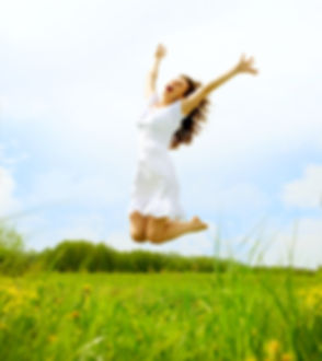 Happy Young Woman Jumping over blue sky.