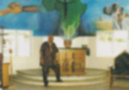 Fernando Arizti stands in front of mural in Nigeria