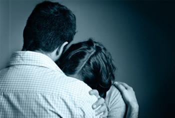 Couple comforting eachother