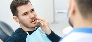 tooth-pain-dentist-925x425.jpg