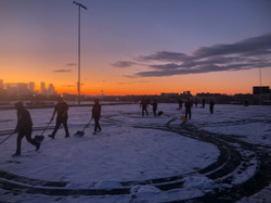Raiders Shoveling Snow