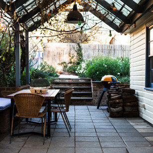Covered outdoor dining area with BBQ