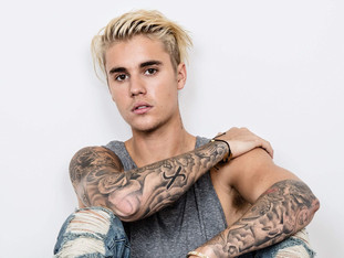Justin Bieber becomes the youngest solo artist in history to earn 100 career entries