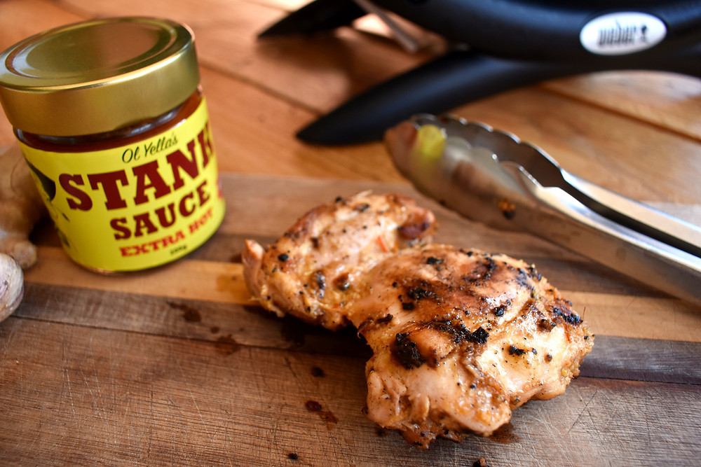Spicy barbecue chicken made with Stank Sauce cooked on the Weber Baby-Q