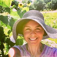 Devon Byrne, nutritional therapy practioner, in the Sunrise Ranch garden in Loveland, CO
