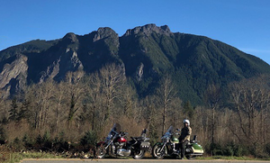 Two motorcycles and a mountain