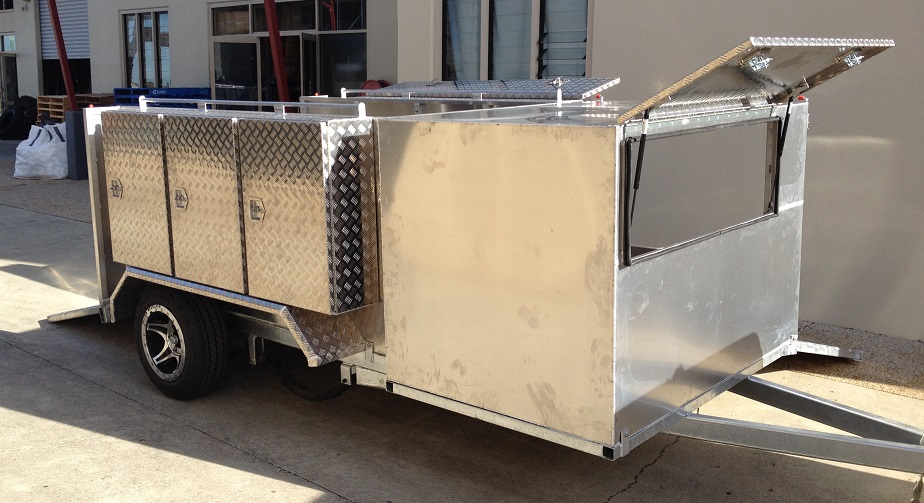 Custom-mower-trailer-with-draw-bar-and-s