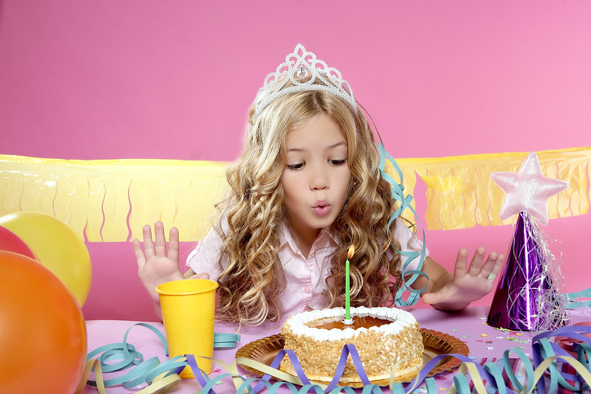 blowing candles birthday party little blond happy girl.jpg