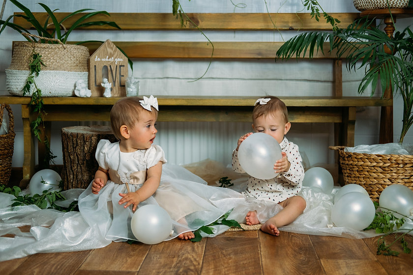 Cute little baby toddler princess at first birthday party at home. 1st Birthday home party
