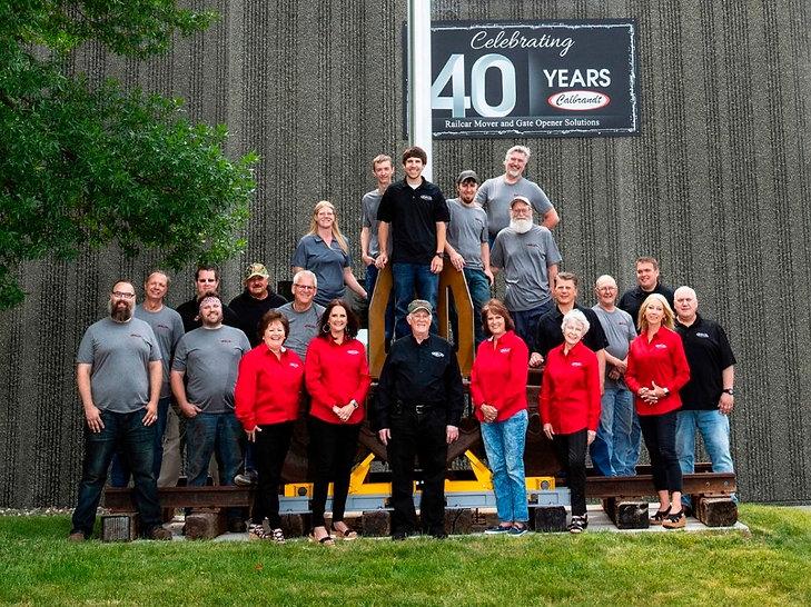Calbrandt-Team-in-Front-of-Flagpole.jpg