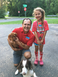 dog holding and girl.jpg