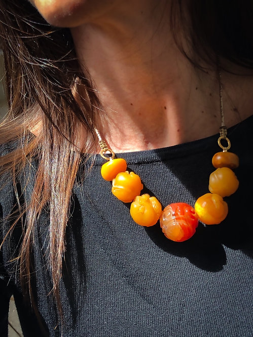 Carved amber and carnelian beads