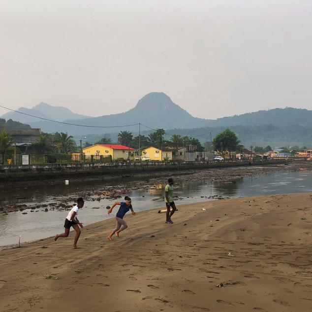 Kids playing on the river bank, Santo Antonio