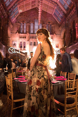 Jodie is wearing a sheer tulle, floral embroidered with shades of red, green and cream