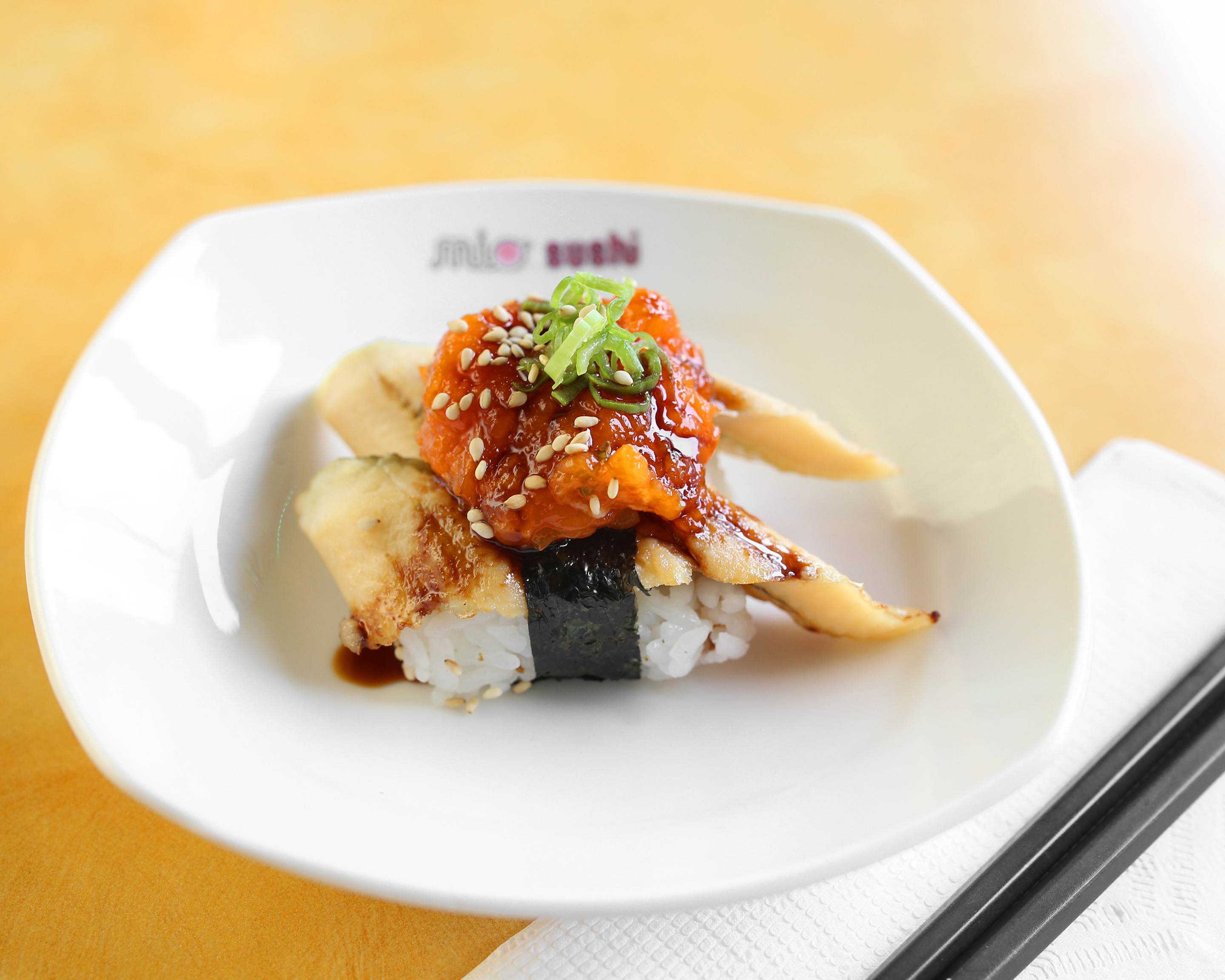 Spicy Salmon on top of Anago