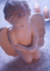 angel-statue-with-candles.jpg