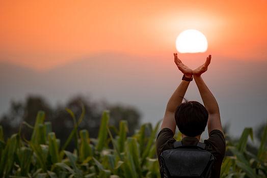 summer-solstice-man holding sun.jpg