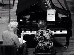 Eliane Reyes rehearsing the Schumann Piano Concerto with Gilbert Varga