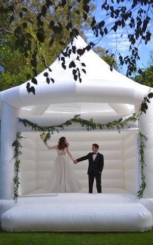 White_wedding_bounce_house_cait