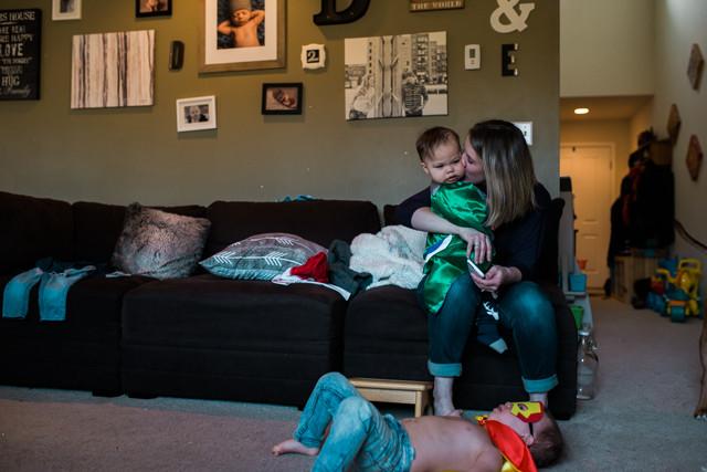 Kent Family Photography boy and mom kiss