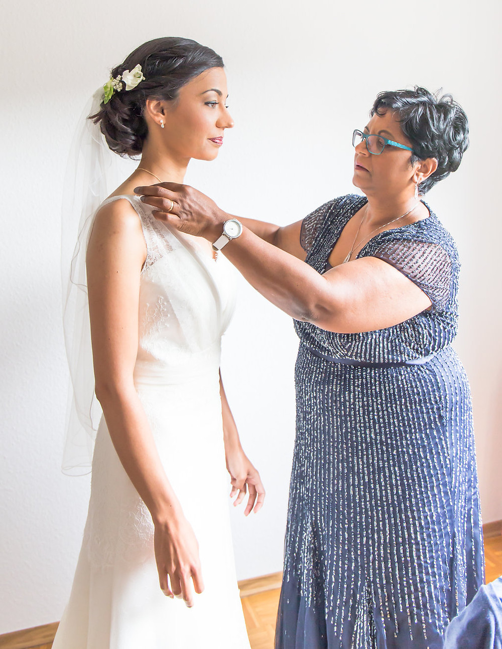 Mother of the Bride with one last check before they leave for the wedding.