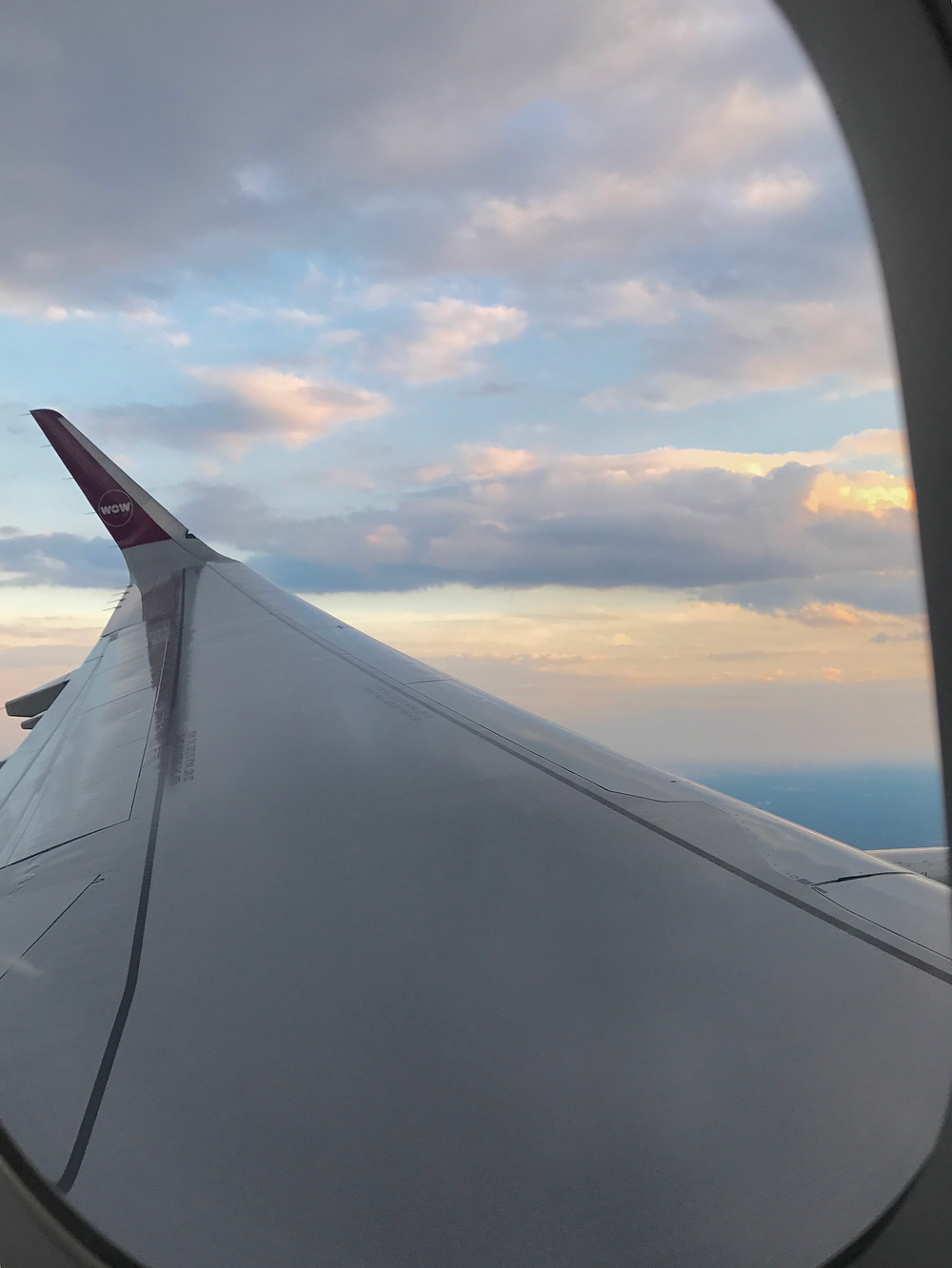 Wow Airlines flight from Baltimore, MD BWI European Travel Window seat sunset travel to Europe Germany Frankfort Germany bound Wedding destination