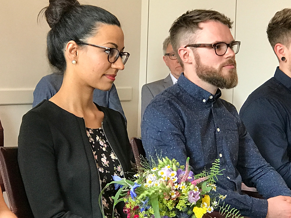 Bride and Groom Sarina and Malte as they listen to the Judge performing the Civil Ceremony at the Oldenburg, Germany Registrars Office.
