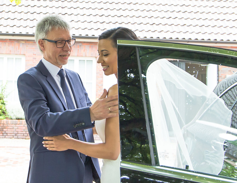 Proud Dad of the Bride seeing her for the first time as she exists the car