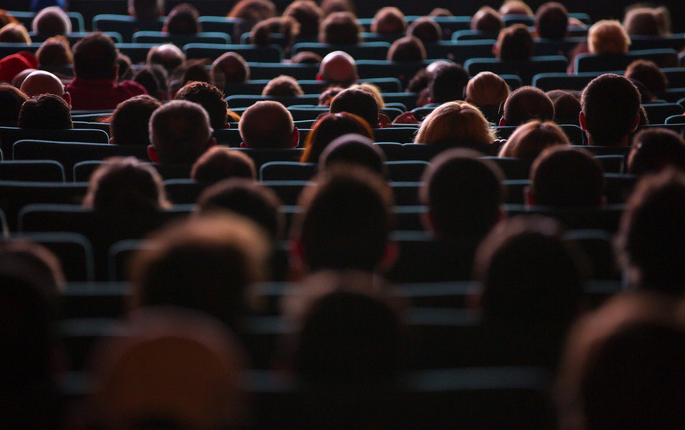 People sitting in theatre seats