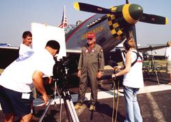 Filming warbird pilot Regis Urschler