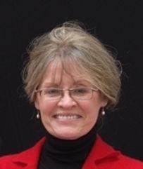 Nancy Headshot in Red.jpg